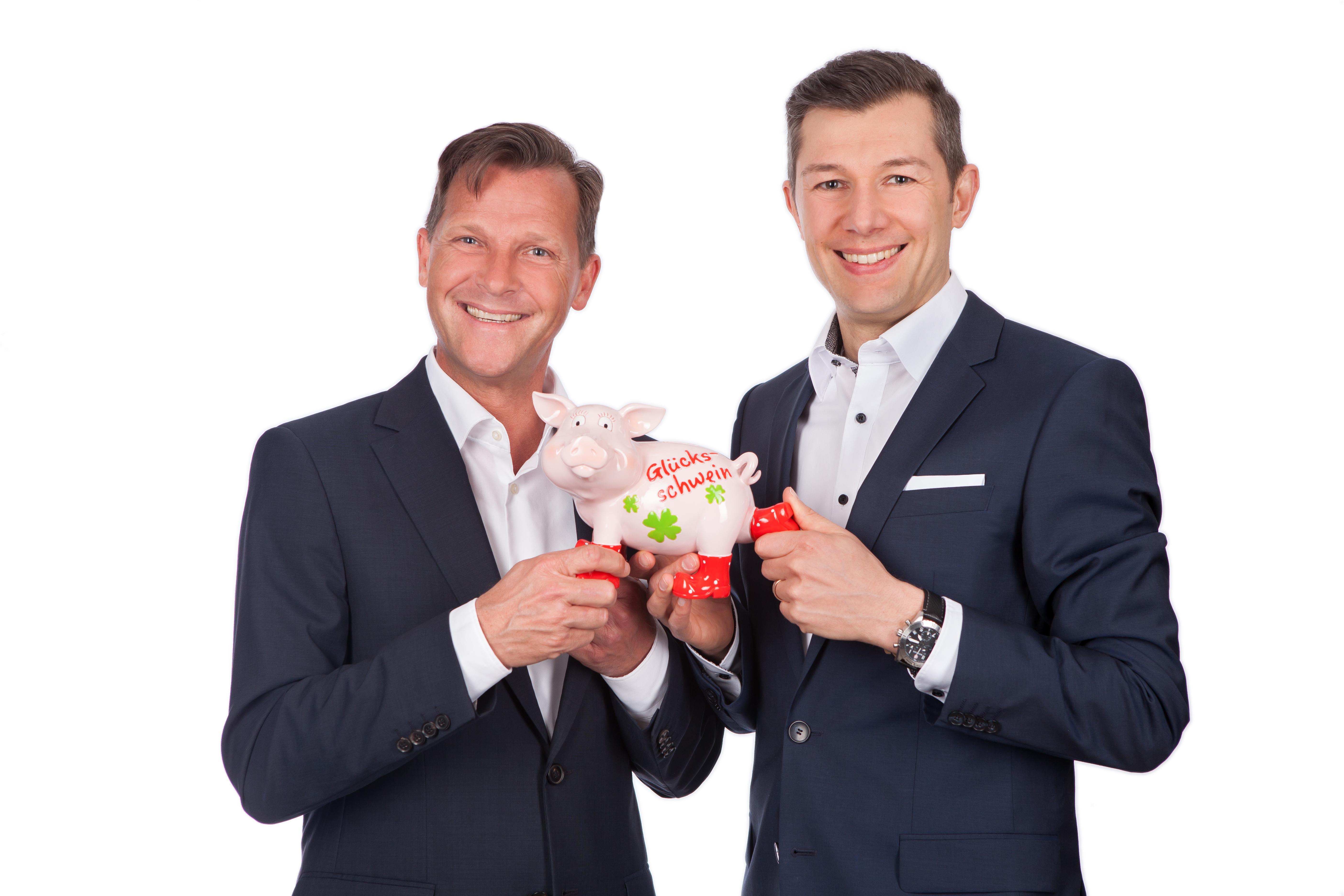 """Professor Dr. Martin-Niels Däfler und Ralph Dannhäuser haben zum Thema """"Glück im Beruf"""" geforscht."""